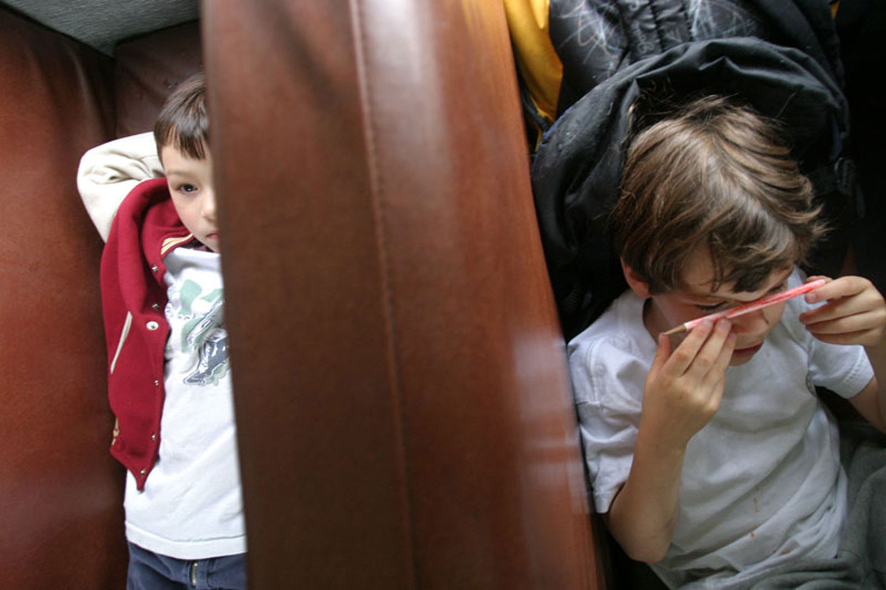 Kids resting while riding on a bus