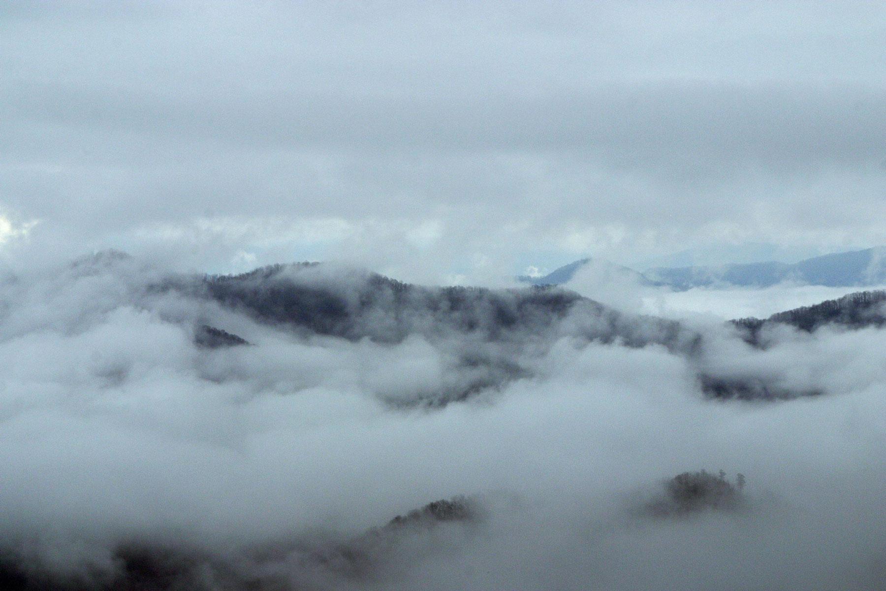 White mountains rising through fog