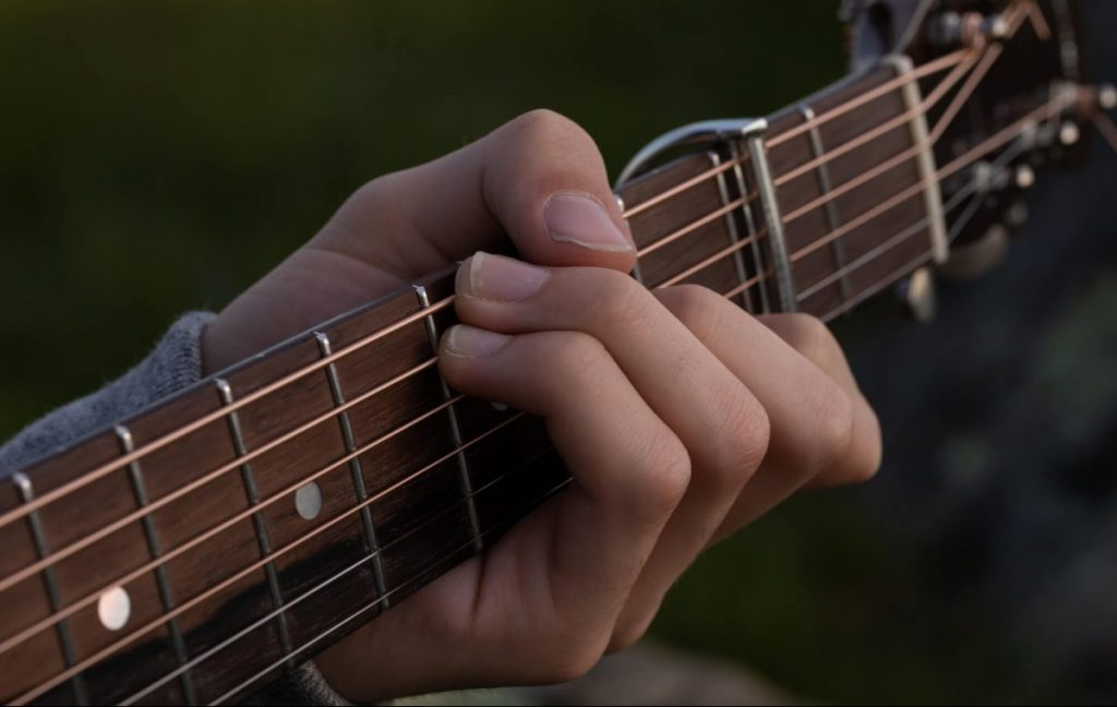 Fingers strumming guitar