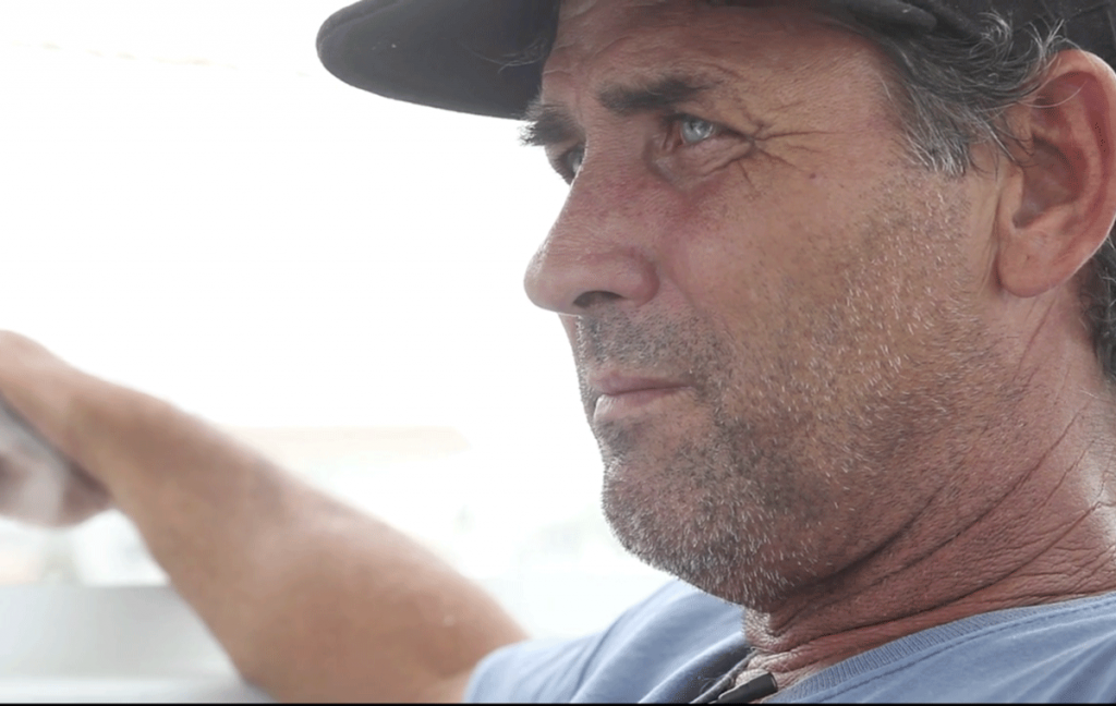 Man on a boat looking into the horizon